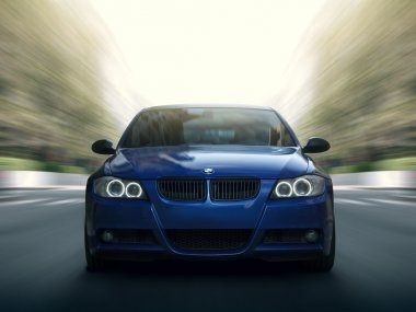 Blue car BMW 5 series E90/E91 Fast speed drive on city road