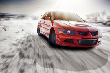Fast drive car speed on the road turn at winter mitsubishi lancer evolution