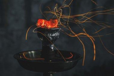 shisha hookah red hot coals. Sparks from breathe