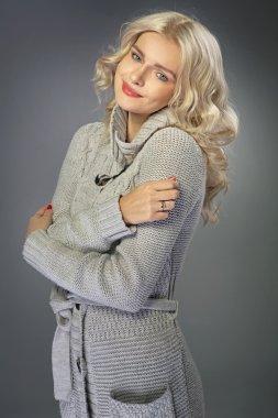 Portrait of a blond woman wearing warm sweater