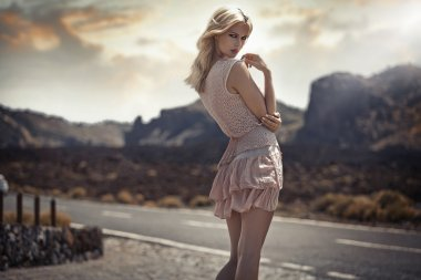 Portrait of the delicate blond lady in the exotic place