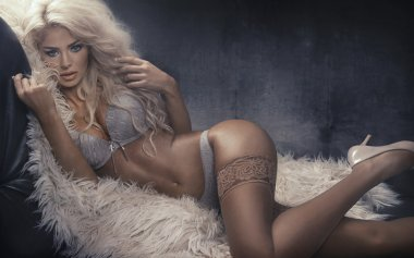 Portrait of the alluring woman wearing sexy lingerie