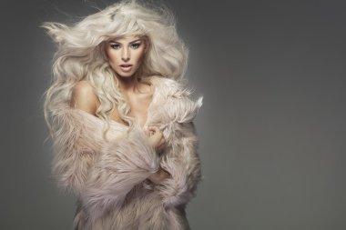 Sensual woman wearing the fur coat