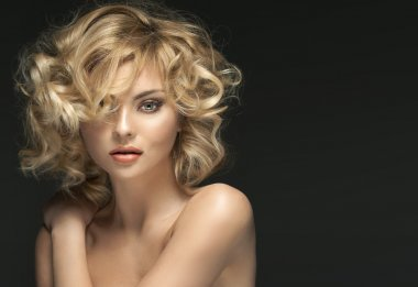 Pretty blond woman with curly hairstyle
