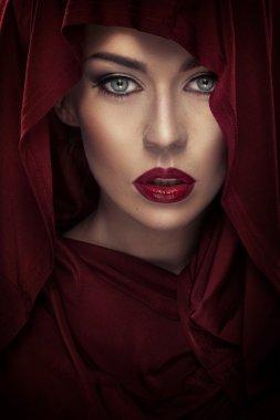 Closeup portrait of a lady wearing a shawl
