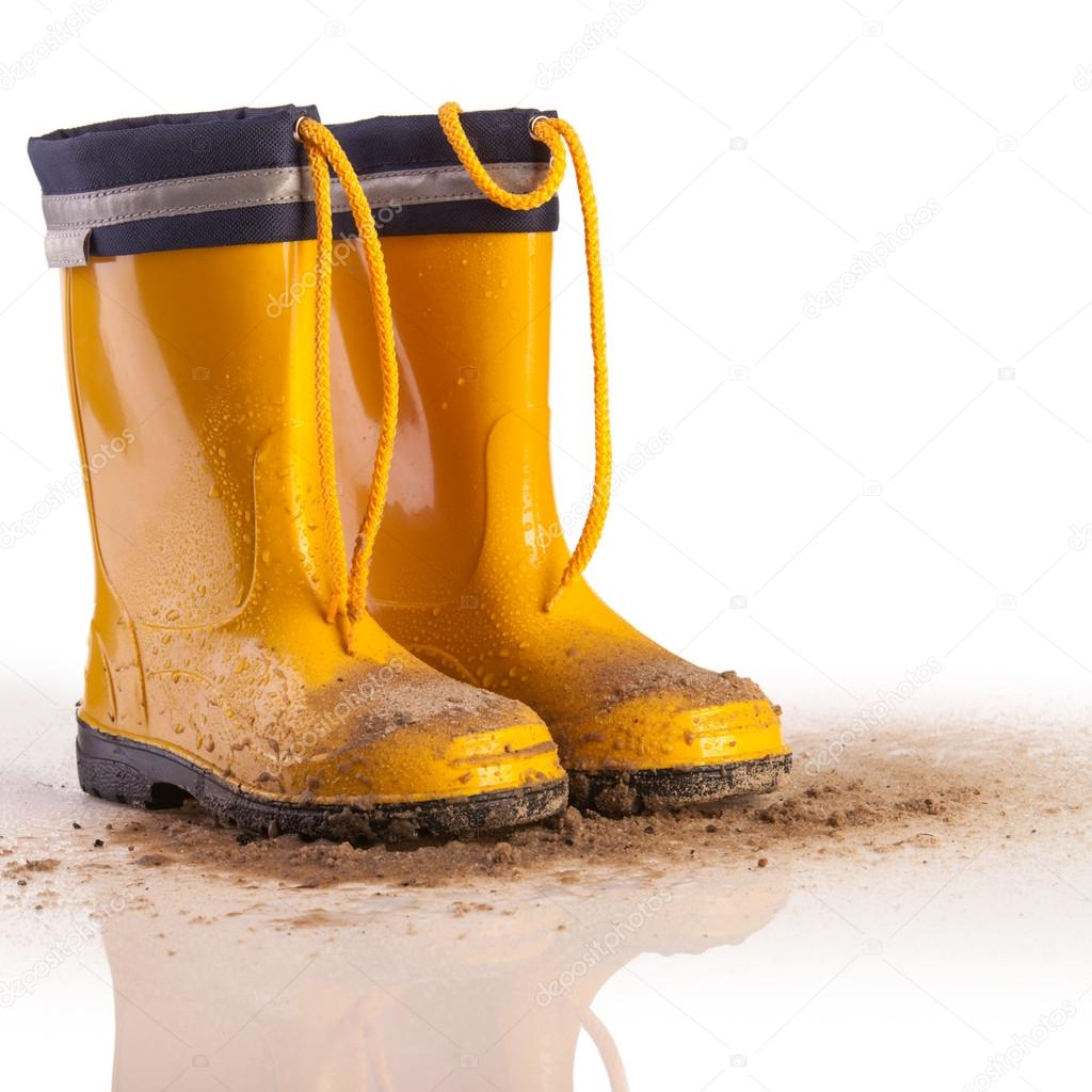 Yellow rubber boots for kids on white background