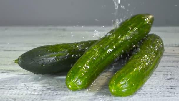 Water splashing on cucumber in slow motion