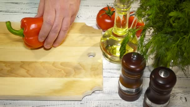 slicing sweet Red Bell Pepper on a wooden cutting board,  4K
