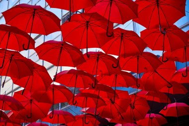 Red Umbrellas In the Air