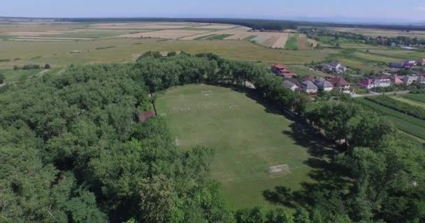 Training at football school, 4k (Aerial)