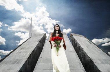 Girl with tulips in Tsitsernakaberd