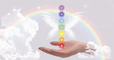 Woman's Healing Hand and The Seven Chakras on a beautiful sky background with rainbow stock vector