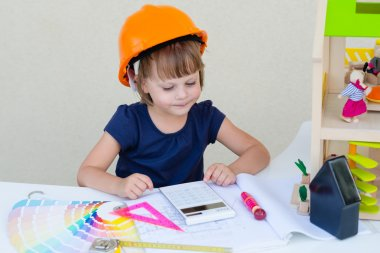 Smiling Little Girl In Orange Protective Helmet - Playing Engineer Or Builder