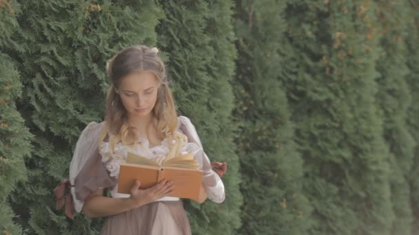 girl reading a book while standing