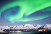 Photo Northern lights above fjords in northern Norway