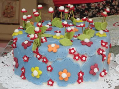 Italian Arts and Crafts. Cake with flowers and plants decorations