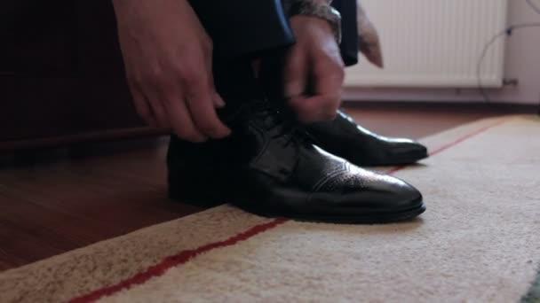 Man Tying Shoelaces