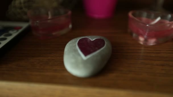 wedding decoration with heart on stone and candles