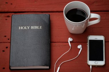 Bible with headphones and coffe