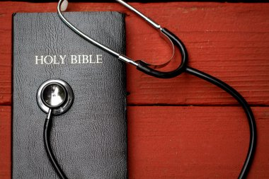 Bible book and medicine stethoscope