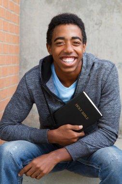 Teenager holding Bible