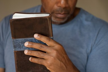 African American man reading the Bible.