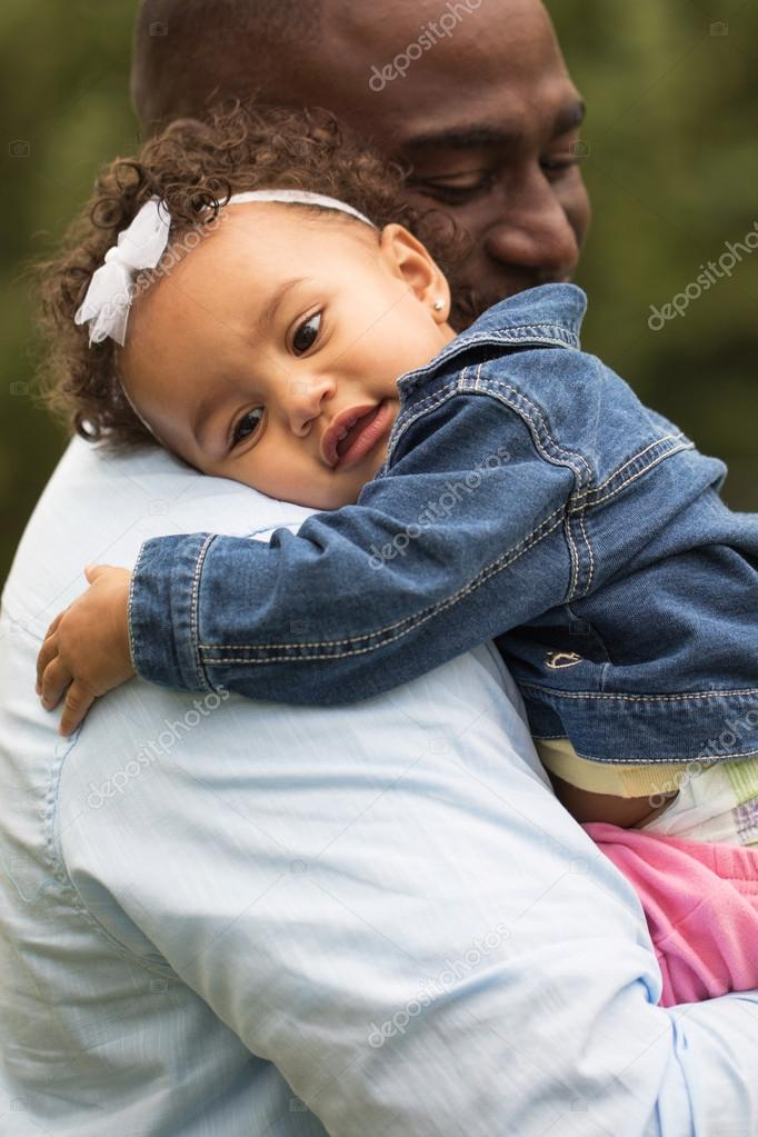 Little girl hugging her father.