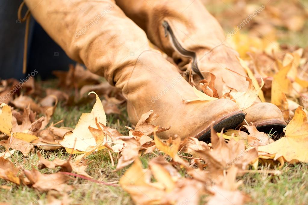 Portrait of a woman wearing boots in the fall.