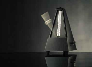 Metronome on grey background - horizontal
