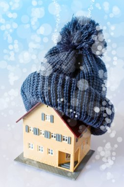 House in winter - heating system concept and cold snowy weather