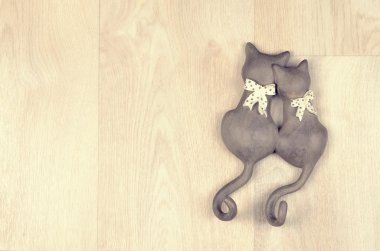 clay toy cats on  a wooden background