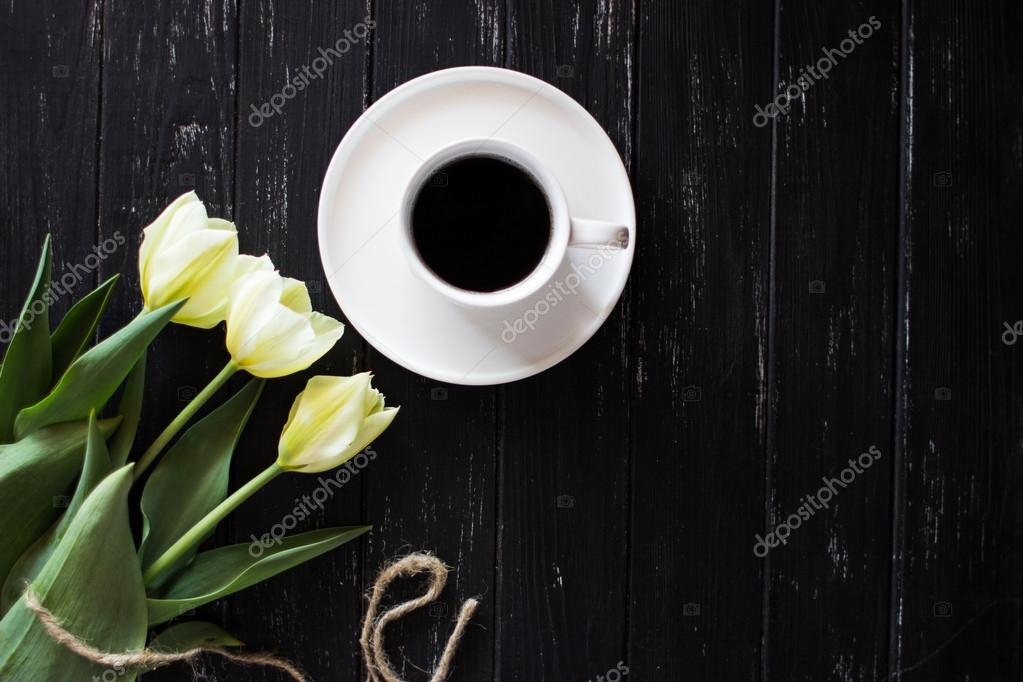 Beautiful pale yellow flowers are on the table stock photo beautiful pale yellow flowers are on the table with a cup of coffee photo by vladataran mightylinksfo