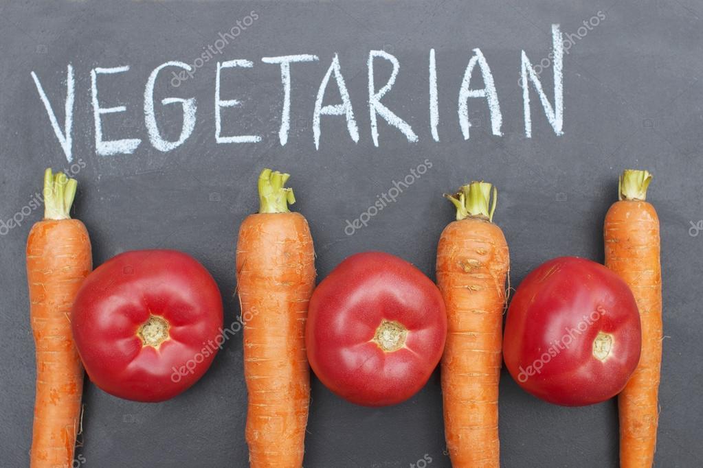 fresh tasty vegetables lying in outdoor garden on wooden table