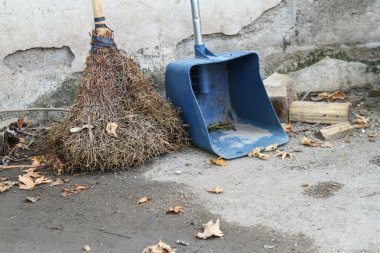 The street cleaning broom in autumn