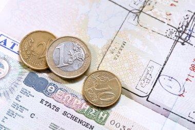 Euro coins on passport with greek European Union visa