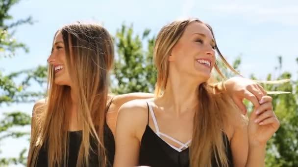 female twins having fun in the sun. hd