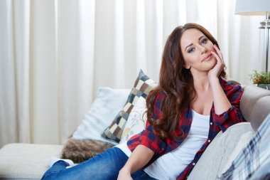 Relaxing woman sitting comfortable in sofa lounge chair
