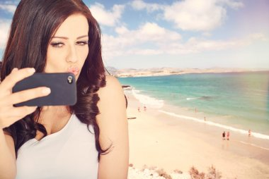 Selfie fun woman taking picture at beach vacation.