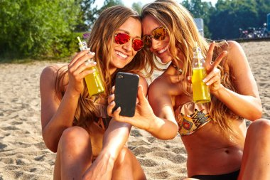 cheerful friends taking selfie