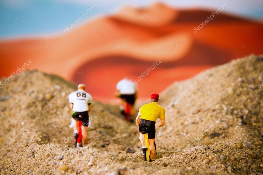 Miniature toy bicycle in desert