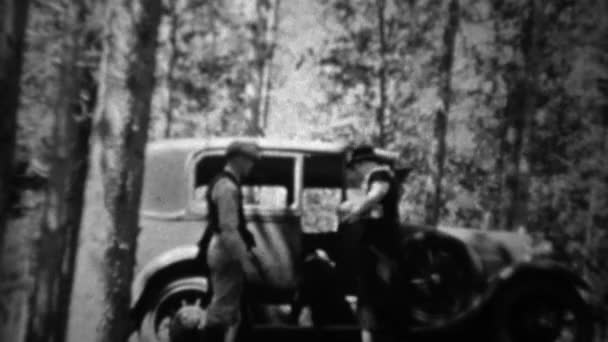 Couple packing car in deep wooded forest