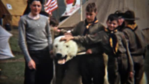 Boyscouts posing with dead polar bear head