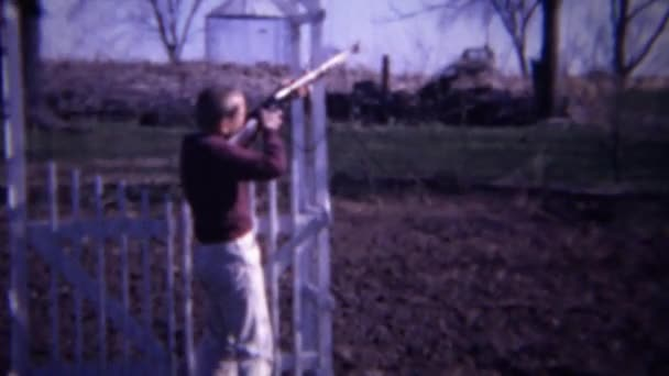 farmboy aiming shotgun at bird targets