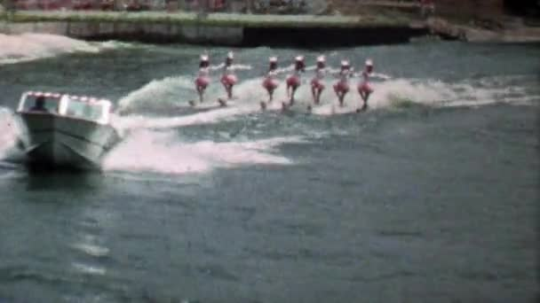 women waterskiing tandem show