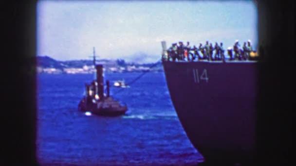 Tugboat pulling troopship maiden voyage
