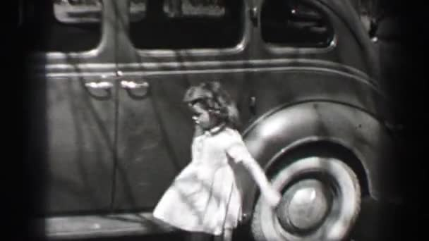 girl closes car door and walks home