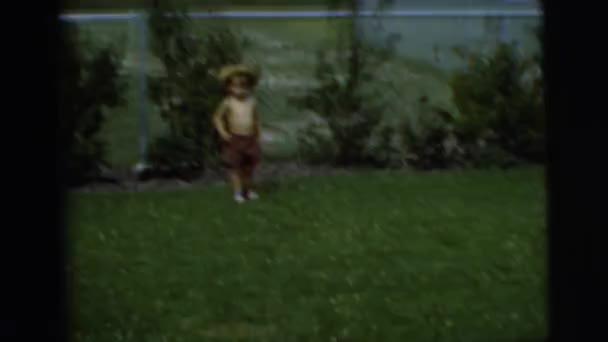 boy running through the yard