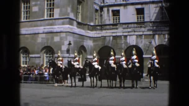 men on horses wait in front of crowd