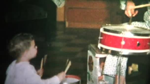 Dad and Son Playing on Drums