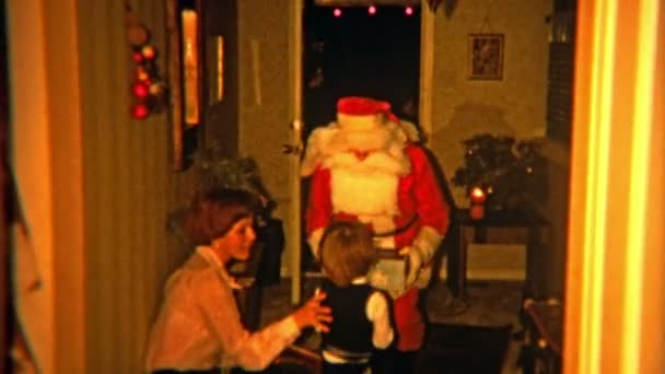 Santa claus coming through front door to visit lucky child
